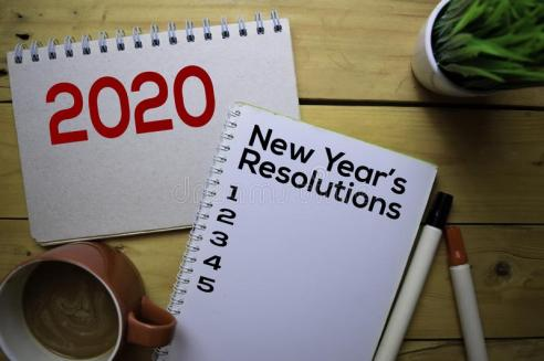 new-year-s-resolutions-write-book-wooden-table-background-162780739.jpg